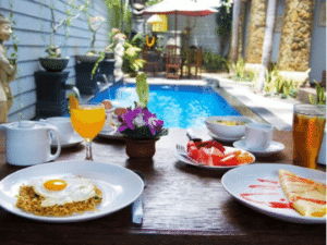 You can eat breakfast overlooking the pool at the Sanur Guest House